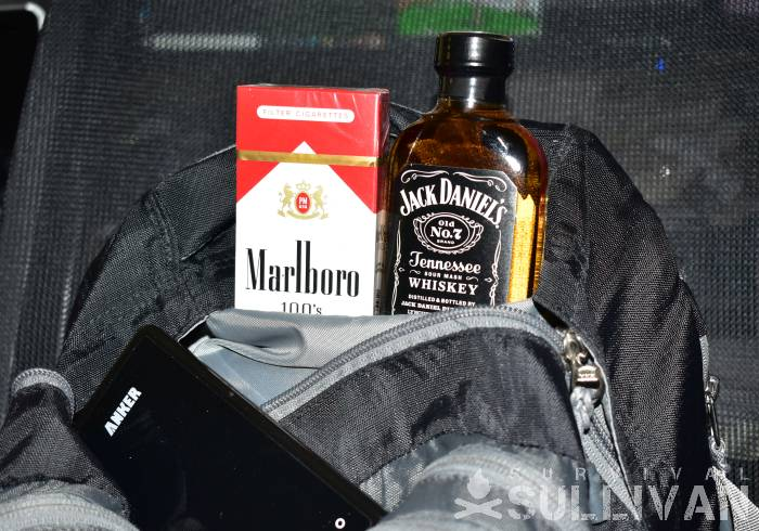 pack of Marlboro and bottle of Jack Daniels